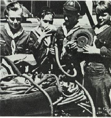 Cub Scouts assisting in a wartime scrap drive.      Click for Larger Image